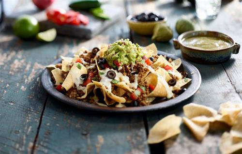 Ground Beef Nachos Topped with Hand-Mashed Guacamole