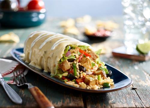 Our Signature Quesorito (burrito covered in our creamy queso)