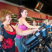 Co-ed and ladies on gyms