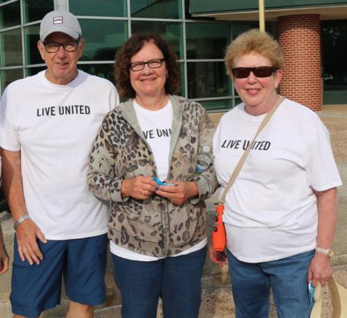 Ed Schultes, Kathy Schultes, and Pat McEvoy volunteering at the 2019 Live Heroic 5K. These three are long-time United Way volunteers.