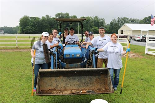 HFM Investment Advisors and Janet Garraty from the Garraty Group volunteered at SHADOW Equestrian as part of Day of Action on June 20, 2019.