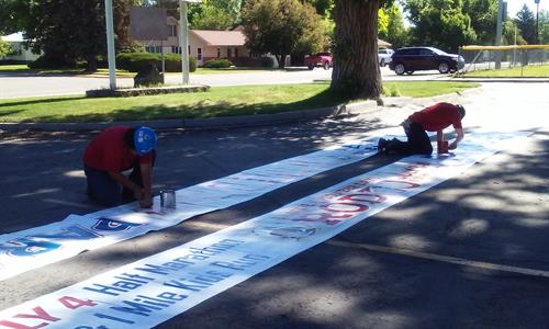 Job Corps Students working on the Fourth of July Festivities banners