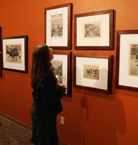 Admiring art by Frederick Remington