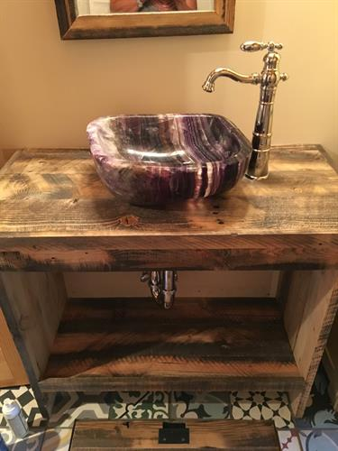 Quartz sink with reclaimed wood vanity
