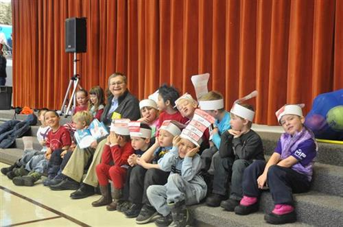 Lander Rotary members read to young students