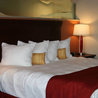 Wind River Hotel & Casino suite king sized bed