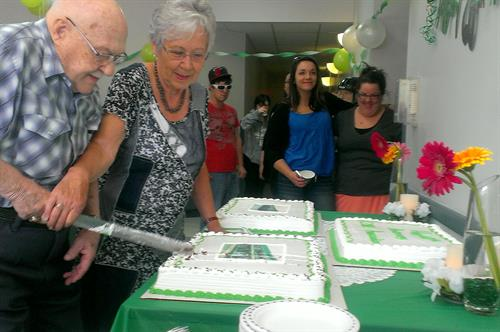 Past presidents Bill Graves and Lorraine Prince cut the cake for CORE's 60th Anniversary.