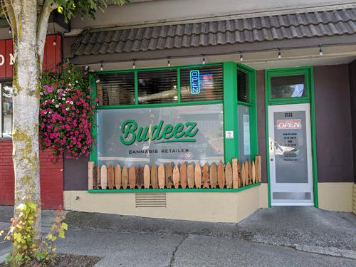 Check out our unique storefront! We love our surf board fence!