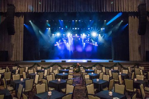 The Admiral Theatre main floor features cabaret-style tables of four with seating for 322 for a full-capacity event.
