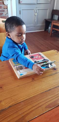 Pre-Primary Student working on The Lock Puzzle