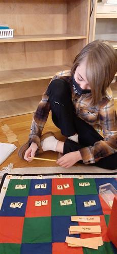 Elementary Student working on Algebra Checker Board