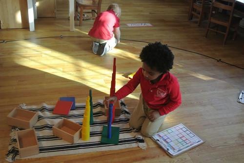 Primary Student working on Knobbles Cylinders