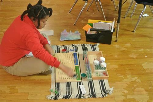 Elementary Student working on Racks & Tubes for long division