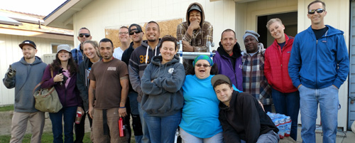 Visalia Rescue Mission Volunteers work with Habitat homeowner partners