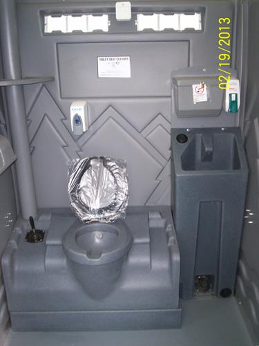 Boudoir Unit. Flushing unit with inside sink and mirror.