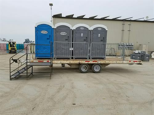 Shower Trailer, Hot water shower comes with propane and bladder to catch water.