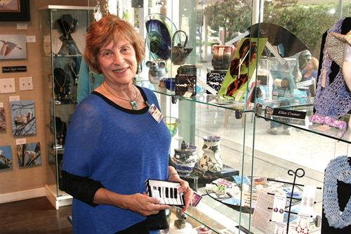 Carol Korfin, one of the Off Track Gallery artists with her fused glass