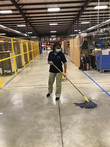 Mopping Warehouse Floor