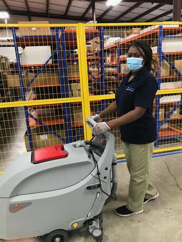 Scrubbing Warehouse Floor