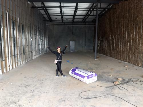 Dr. Cathy Cupples standing in the space before the buildout