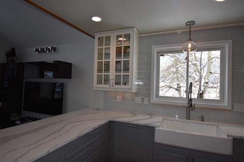 Single bowl Farm House sink with glass backlit upper cabinet