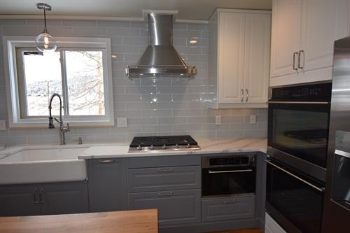 Wall exhaust hood, double oven, and under counter microwave