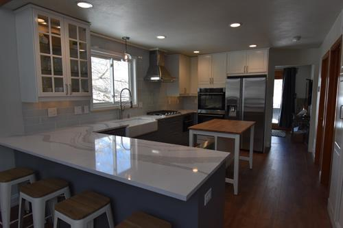 Kitchen remodel with peninsula overhang seating