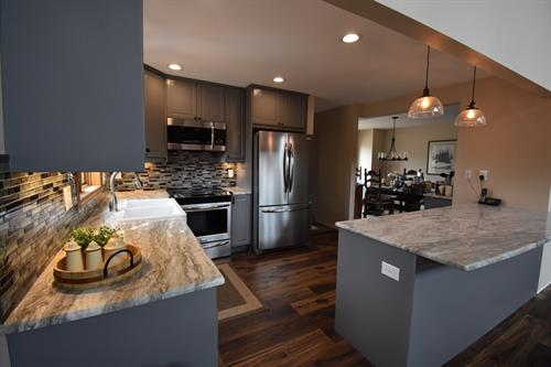 Grey shaker cabinets with granite countertops