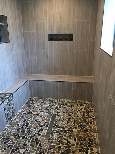 Large walk in shower with bench