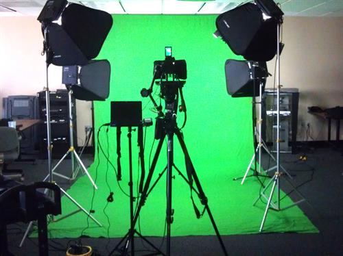 Typical greenscreen on location, with teleprompter.