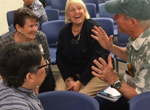 Spirited discussions happen at Village Network events.
