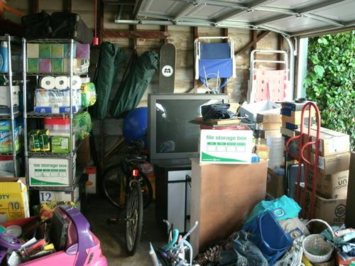 Garage BEFORE our Decluttering Services!