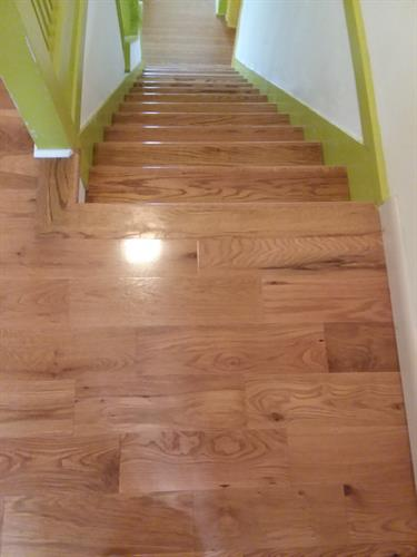 golden oak prefinished hardwood installation landing hall staircase renovation