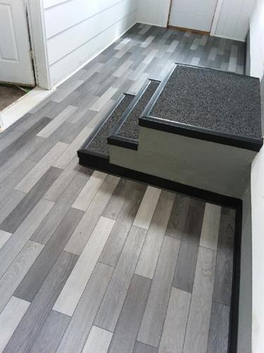floating LVP floor and tile steps