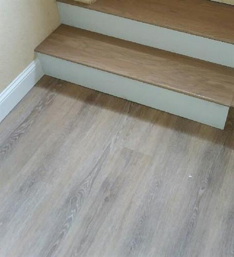 glue down wood look viny plank, treads and risers over concrete floor and steps