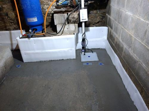 Corner with new sump pump system and ports for proper drainage maintenance