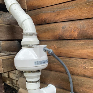 Radon fan installed outside