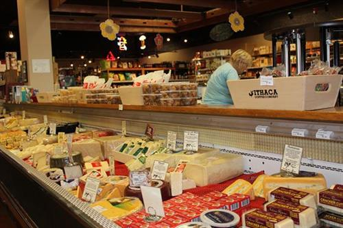 Local and imported artisanal cheeses at Triphammer
