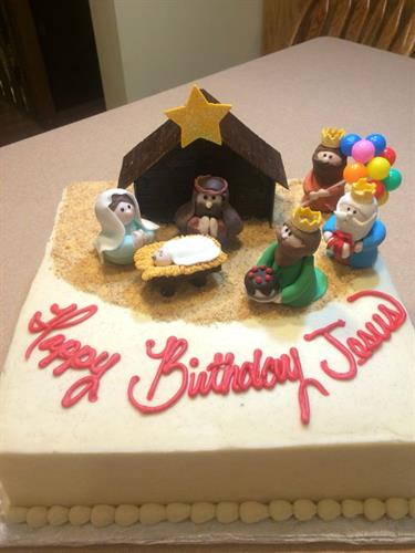 Brithday Cake for Jesus.  The manger scene and people are all hand sculpted