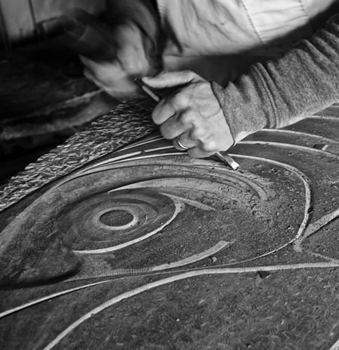 Adam carving sculptural ornament