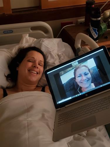 Gallery Image donna_in_bed_virtual_me_on_laptop_pic.JPG