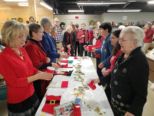 Volunteers enjoying themselves playing Jingle Bell toss