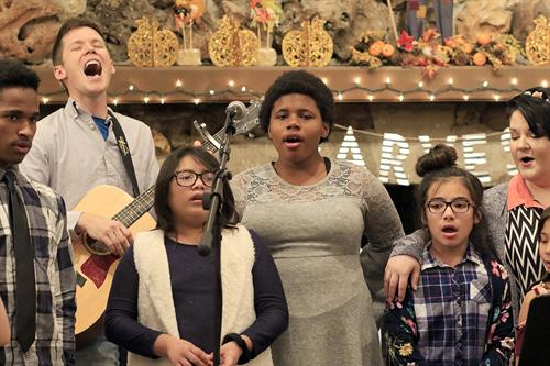 Jonah our music minister leading the kids in song during our 2018 Thanksgiving celebration!