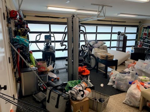 Before photo of garage and gym organizing session