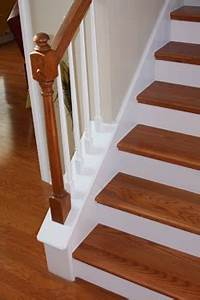 Wood floors on stairs with white risers