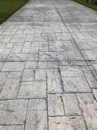 Before Picture of  faded stamped concrete