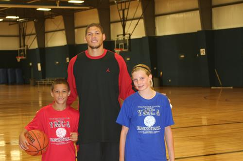Homecourt Coach with two youth
