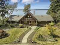 Spectacular custom log home on waterfront
