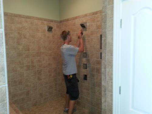 Josh finishing the trim on this custom shower