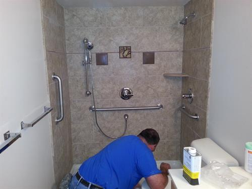 Custom shower. Tim July is finishing the tile